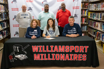Jessica Robinson, center, signs to play basketball for Penn State-Shenango in the company of her parents, Barry and Kim. Standing from left Penn State-Shenango Head Girls Basketball Coach Daniel Johnson; WAHS Head Basketball Coach Terrill Seward and Assistant Coach Sean Walker.