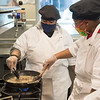 Students working with Chef Donald Schmitter  in the Hospitality and Tourism HTR100Multicultural Foods class at SUNY Buffalo State College.