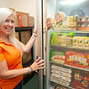 Kristen Helling with the new Milligan's Food Pantry refrigerator at SUNY Buffalo State College.