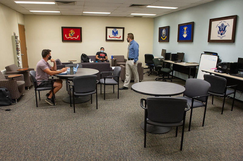 Coordinator of Military & Veteran Services Brad Baumgardner in veteran's lounge at SUNY Buffalo State College.