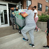 Football players moving into Neumann Hall at SUNY Buffalo State College.