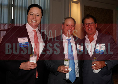 Ronald Mills, (center) with MM50 first place finisher, Comstock Resources with Ryan Hoopes, (left) and Tom Sutherland from event sponsor Cushman & Wakefield..