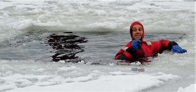 DA104,DJ, Brrrr! Dubuque Haz Mat Team Member Demos Ice Rescue on  the Mississippi River  Service with a Smile!