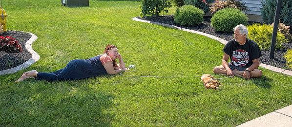 210913 Lawn Enterprise James Neiss/staff photographer  Wheatfield, NY - The grass was actually greener at the Lapusnak residence on Skylark Lane in Wheatfield where Michelle & John Lapusnak and their dog Oscar decide to spend the afternoon enjoying the late summer sunshine.