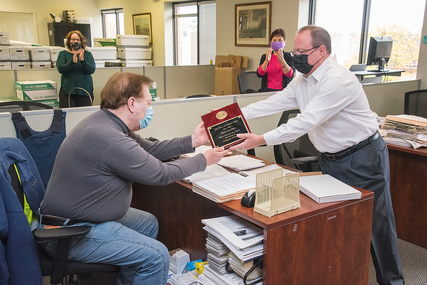 210427 Pfeiffer 2 <br /> James Neiss/staff photographer <br /> Niagara Falls, NY - Niagara Gazette Publisher John Celestino announced that reporter Rick Pfeiffer has been named Reporter of the Year in The Best of CNHI 2020 contest.