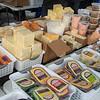 210220 Winter Markets 4<br /> (James Neiss/staff photographer)<br /> North Tonawanda, NY - Tina Kislack of Tina's Cheese keeps her booth stocked with a large variety at the North Tonawanda Farmers' Market.
