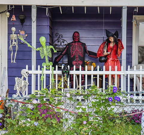 211010 Mannequin Enterprise<br /> James Neiss/staff photographer <br /> Olcott, NY - The change of season means a change of dress for the one-armed Olcott Mannequin, right, on Lockport Street in Olcott, who was joined by some spookie characters for the Halloween season.