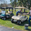 210408 Enterprise 1<br /> James Neiss/staff photographer <br /> Lockport, NY - Beau Brylski and his father Dave Miller, owner of the Gothic Hill Golf Course, spruce up a few carts before lunch.