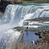 210426 NF Tourism 2 <br /> James Neiss/staff photographer <br /> Niagara Falls, NY - The Big Picture - A tourist gets his shot during a visit to Goat Island at Niagara Falls State Park. The couple traveled from Detroit to see the sights.