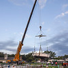 211010 End of Season 2<br /> James Neiss/staff photographer <br /> Wilson, NY - Members of the Tuscarora Yacht Club on Clark Island joined forces with a giant crane from Clark Rigging to take boats out of the water for the season in Wilson Harbor.