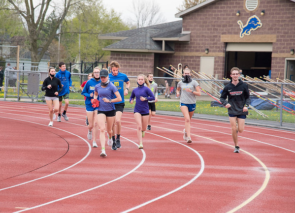 210503 LKPT Track 1<br /> James Neiss/staff photographer <br /> Lockport, NY - Distance runners take a few laps on the first day of Lockport High School track practice.