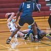 210220 Starpoint Bball 2<br /> (James Neiss/staff photographer)<br /> Pendleton, NY - Starpoint boys basketball player #23 Sam Lee looks to pass after falling down during game action against Sweet Home.