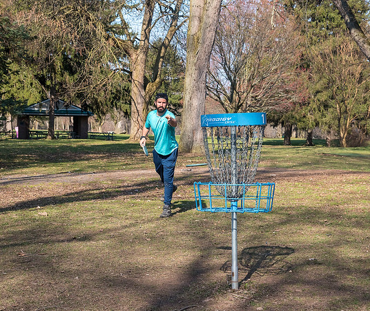 210407 Lockport Parks 2<br /> James Neiss/staff photographer <br /> Niagara Falls, NY - Michael Fretthold plays a round of disk golf at Outwater Memorial Park.