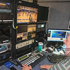210504 LKPT Enterprise<br /> James Neiss/staff photographer <br /> Lockport, NY - LCTV remote production director Phil Czarwecki mans the controls of the mobile production van outside Lockport High School getting ready to go live with the Boys volleyball game there.
