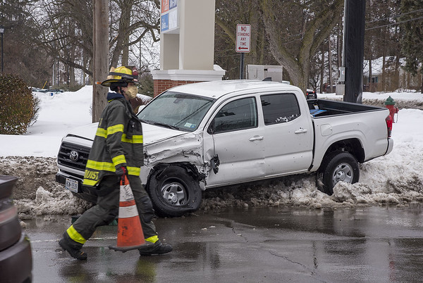 210222 Lkpt Enterprise<br /> (James Neiss/staff photographer)<br /> Lockport, NY - Emergency responders deal with a fender bender crash at the corner of South Transit and Summit Street.