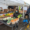 210220 Winter Markets 2<br /> (James Neiss/staff photographer)<br /> North Tonawanda, NY - Jennifer Kham of Amherst shops for her family Henry, 2, and husband Sai at the Senek Farms booth at the North Tonawanda Farmers' Market. Kham said it was the first time they've been there after searching for a market open in the winter.