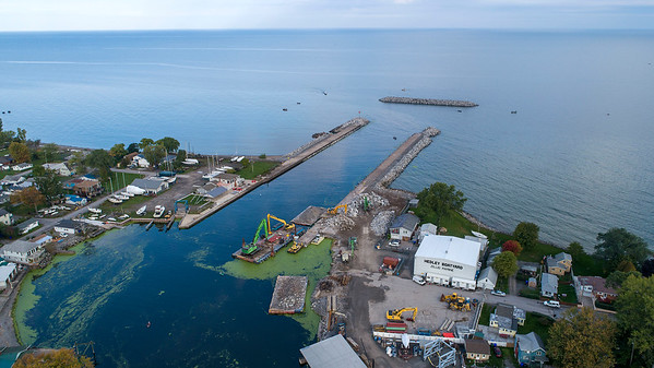 211010 Olcott Harbor 2<br /> James Neiss/staff photographer <br /> Olcott, NY - Anglers enjoy the quiet Sunday morning fishing on Lake Ontario at Olcott Harbor. The new breakwall is now in place as work continues along the piers.