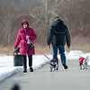 210224 Enterprise 2<br /> (James Neiss/staff photographer)<br /> Lockport, NY - Nice Weather Walk - Patricia Barry and her dog Dixie took advantage of the warm winter day to walk with others at Day Road Park.