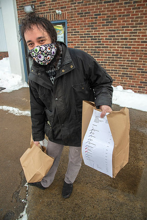 210220 Winter Markets 6<br /> (James Neiss/staff photographer)<br /> Lockport, NY - John Emmo of Lockport used the pre-order service then picked it up at the Lockport Community Farmers Market on Saturday. The market features pre-order pick up. The market is located at the South East corner of the Harrison Place building.
