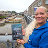 """211005 Goins Book 1<br /> James Neiss/staff photographer <br /> Lockport, NY - Local author Tasha Goins has published her book titled """"Upstate Hustle,"""" book 1."""