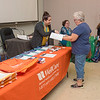 211007 Dale Enterprise 1<br /> James Neiss/staff photographer <br /> Lockport, NY - Melissa Lee with WellCare helps Linda Hurst of Middleport pickout a Medicare supplemental medical plan during a Medicare & Health Insurance Fair at the Dale Association.
