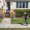 210408 Enterprise 3<br /> James Neiss/staff photographer <br /> Wilson, NY - Hop and a Skip - Xavier Michael, 7, visiting from Georgia, plays Hopscotch during a visit with his grandfather Mark Hillman in front of his home in Wilson.