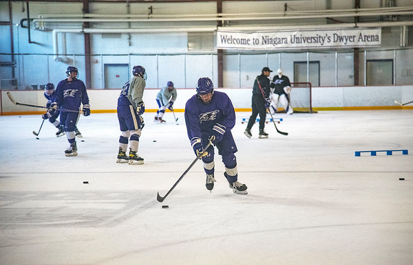 210920 NU Hockey DeBoer James Neiss/staff photographer  Lewiston, NY - Niagara University hockey player #27 Jack DeBoer moves the puck toward the net during drills at practice.