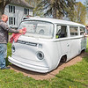 "210427 Enterprise 3A<br /> James Neiss/staff photographer <br /> Pendleton, NY - Ella Goudy, 15, gets help from her father Eric turning an old Volkwagon van into a vegetable stand in front of their Irish Road home. The family plans to call their stand ""VW Homestead"" and sell vegetables, fresh eggs, fruit and wildflowers."