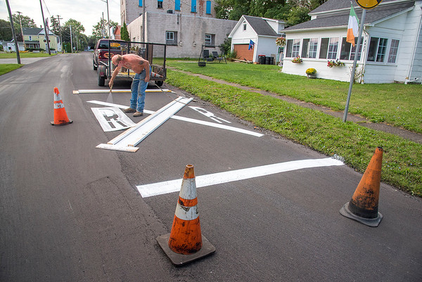 210913 RR Enterprise James Neiss/staff photographer  Gasport, NY - X marks the spot - JR Rehwaldt of Rehwaldt Sealing & Stripping said this railroad crossing at the corner of Central Avenue and State Street in Gasport  is one of over 18 railroad crossings he's repainted this summer.