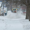 210126 Winter Storm 4<br /> (James Neiss/staff photographer)<br /> Lockport, NY - Niagara County employee Jason Tower uses a giant spinning brush to clean off the sidewalks of snow around the County Building during a break in the snowstorm.