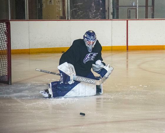 210920 NU Hockey Veltri James Neiss/staff photographer  Lewiston, NY - Niagara University hockey player #31 Chad Veltri deflects the puck during practice.
