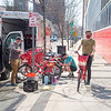 210407 Reddy Bike 1<br /> James Neiss/staff photographer <br /> Niagara Falls, NY - Reddy Bike crews prepare bicycles for the new season outside their 1st Street warehouse. From left are Fleet Manager Matthae Rebmann, Director of Operations Nathan Schultz and testing a bike is Fleet Managara Brenton Heath. The crew said downtown demand for the bikes are already high seeing the racks they just filled were almost empty.