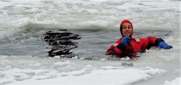 04,DA104,DJ, Brrrr! Dubuque Haz Mat Team Member Demos Ice Rescue on  the Mississippi River  Service with a Smile!
