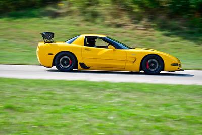 2021 SCCA Pitt Race TNIA Aug Adv Yellow Vette 1