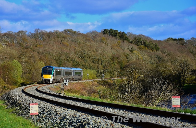 22004 passes alongside the River Flesk at Yellow Quarry Crossing outside Killarney with the 1725 Mallow - Tralee. Sun 11.04.21