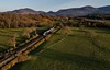 22004 has just passed Yellow Quarry Crossing and is seen at Clasheen outside Killarney with the 1905 Tralee - Cork. Wed 14.04.21
