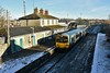2807 + 2808 arrives at a snow covered Nenagh with the 1005 Ballybrophy - Limerick. Sat 09.01.21