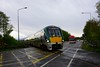 22059 passes Minish Level Crossing (XT102) with the 1705 Tralee - Cork. Held at the level crossing is Bus Eireann's SP79 working the 1650 Tralee - Cork Route 40 Expressway service. Sat 01.05.21