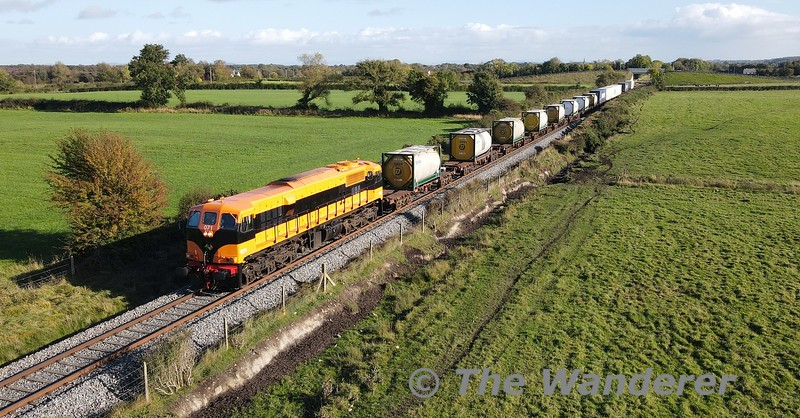 071 is pictured passing Shanderry with the 1125 Waterford - Ballina XPO Liner. The train had been cancelled the previous day due to a issue with one of the wagons. The offending wagon was left in Waterford and it operated on Thursday as a 17 bogie train. Thurs 21.10.21