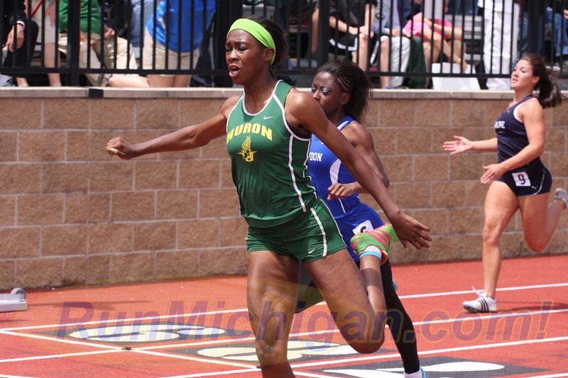 Cindy Ofili competing for Ann Arbor Huron High School at the 2012 Michigan High School Athletic Association Lower Peninsula Division One Track and Field Finals in June of 2012. Photo by RunMichigan.com.
