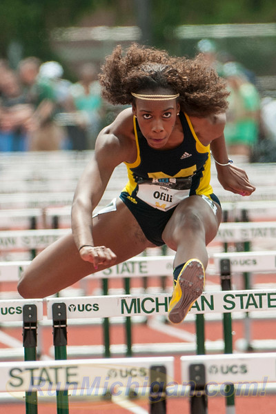 The University of Michigan's Cindy Ofili during the 100M Hurdles at the 2015 Big Ten Outdoor Track and Field Championships, held at Michigan State University. RunMichigan photo by Ike Lea.