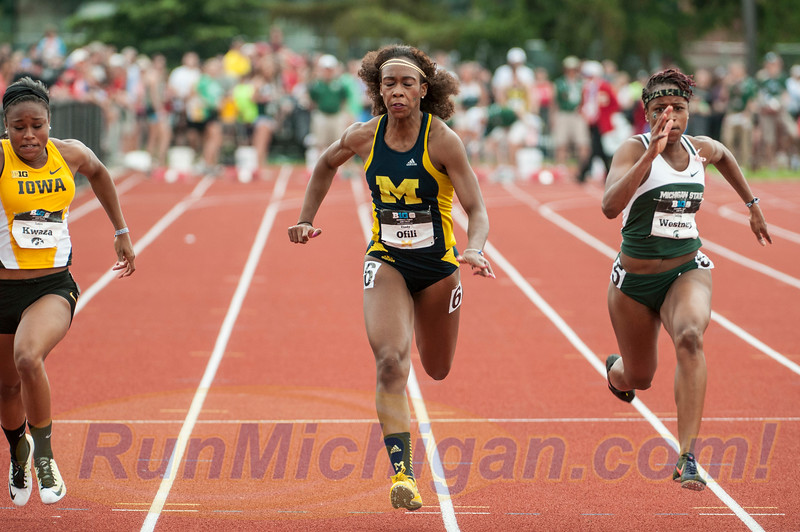 The University of Michigan's Cindy Ofili at the finish of the 100 Meters at the 2015 Big Ten Outdoor Track and Field Championships, held at Michigan State University. RunMichigan photo by Ike Lea.