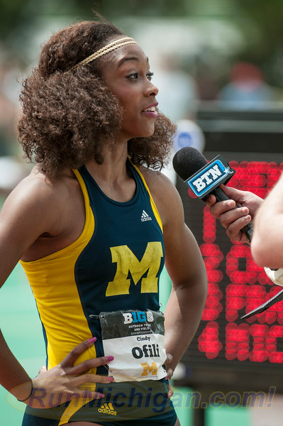 The University of Michigan's Cindy Ofili during her post race interview with the Big Ten Network, at the 2015 Big Ten Outdoor Track and Field Championships, held at Michigan State University. RunMichigan photo by Ike Lea.