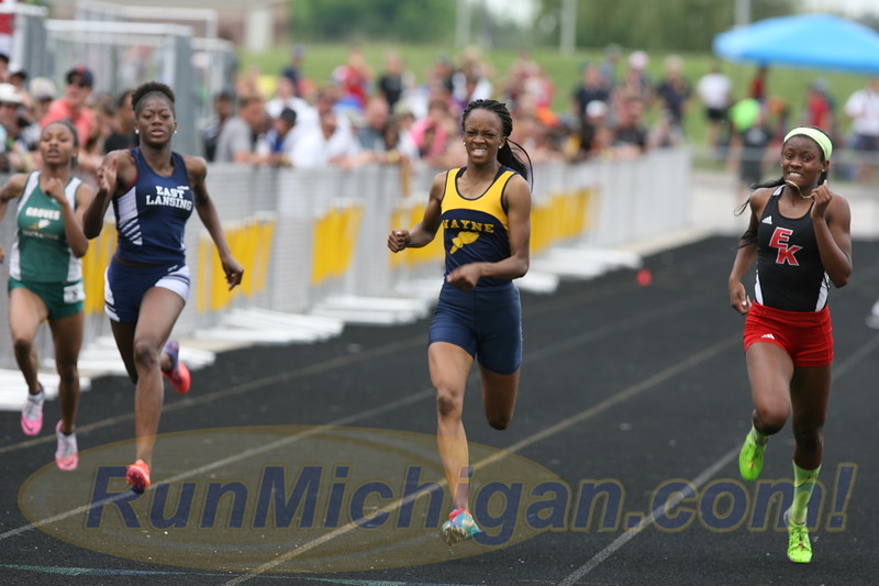 Anavia Battle (center) of Wayne Memorial High School and Taylor Manson (left) of East Lansing High School, at the 2016 Michigan High School Athletic Association LP Division One Track and Field Finals. RunMichigan photo by Carter Sherline.