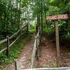 recreational picnic area direction sign and path to the woods
