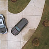 two cars parked in private driveway