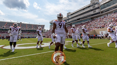 DL Wilfred Pene (91) warms up before the game. (Mark Umansky/TheKeyPlay.com)