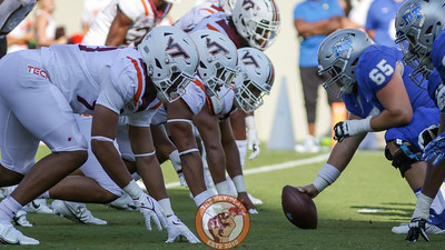 The Virginia Tech defensive line waits for the snap. (Mark Umansky/TheKeyPlay.com)