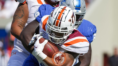 RB Jalen Holston attemps to run with the football while being tackled. (Mark Umansky/TheKeyPlay.com)