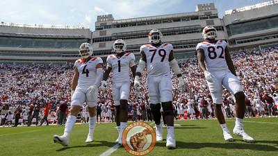 The Virginia Tech captains walk towards mid-field for the pre-game coin toss. (Mark Umansky/TheKeyPlay.com)
